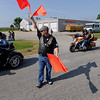 Record-Eagle/Keith King<br /> Steve DeBusschere, Northern Chapter Harley Owners Group member, directs motorcyclists as they park Sunday, July 17, 2011 near Classic Motor Sports prior to the start of the annual Ride for Father Fred.