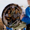 Record-Eagle/Keith King<br /> Spectators are visible from the reflection of a bass drum as the Kalkaska High School marching band performs Monday, October 10, 2011 during the annual Thirlby High School Marching Band Exhibition at Thirlby Field. Eighteen regional high schools took part in the event.