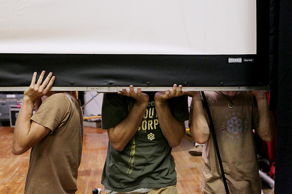 Record-Eagle/Keith King<br /> A projection screen is put into place with the help of the SEEDS Youth Conservation Corps Wednesday, July 20, 2011 in Lars Hockstad Auditorium at Central Grade School in preparation for the upcoming annual Traverse City Film Festival.