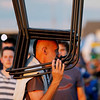 """Record-Eagle/Jan-Michael Stump<br /> Andrew Czop (cq) of Naperville, Il, carries chairs for his family to the Open Space for Friday's Traverse City Film Festival presentation of """"The Dark Knight."""""""
