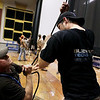 Record-Eagle/Keith King<br /> Adam Young, left, with the SEEDS Youth Conservation Corps, and Jeff Timmerman, right, with BlueWater Technologies, help raise a projection screen in Lars Hockstad Auditorium at Central Grade School Wednesday, July 20, 2011 in preparation for the upcoming annual Traverse City Film Festival.