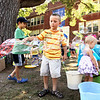 Record-Eagle/Keith King<br /> Jacob Harrison, 5, of Leland, makes bubbles along with Jack Enwright, left, 6, of Birmingham, as Ellianna Hansen, right, 1 (22 months), stands near Friday, July 29, 2011 during the Traverse City Film Festival Kids Festival at Central Grade School.