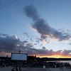 """Record-Eagle/Jan-Michael Stump<br /> The sun sets before the start of Friday's Traverse City Film Festival presentation of """"The Dark Knight,"""" at the Open Space."""