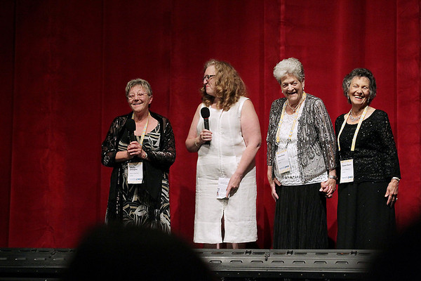 """Record-Eagle/Keith King<br /> Kathleen Glynn, second from left, stands with Sheila Douglas, far left, Vera Sime, second from right, and Gwen Davis, far right, as they address the audience in the State Theatre prior to the showing of """"Made in Dagenham."""" Glynn's guests were real life participants in a Ford Motor Plant strike on which the film is based."""