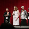 "Record-Eagle/Keith King<br /> Kathleen Glynn, second from left, stands with Sheila Douglas, far left, Vera Sime, second from right, and Gwen Davis, far right, as they address the audience in the State Theatre prior to the showing of ""Made in Dagenham."" Glynn's guests were real life participants in a Ford Motor Plant strike on which the film is based."