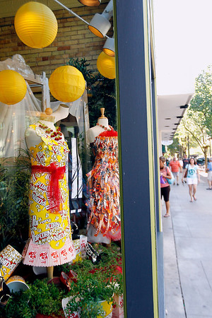 Record-Eagle/Jan-Michael Stump<br /> Movie theater snack-inspired dresses, such as these made from popcorn boxes, by Ginelle Dekker sit on display in the window of What To Wear in downtown Traverse City during the Traverse City Film Festiva.