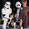 Record-Eagle/Keith King<br /> Evan Chase, 5, of Traverse City, has his photo taken by his father, Chris Chase, as he stands with characters from Star Wars movies Tuesday, July 26, 2011 prior to the start of Star Wars Episode V: The Empire Strikes Back at the Open Space.