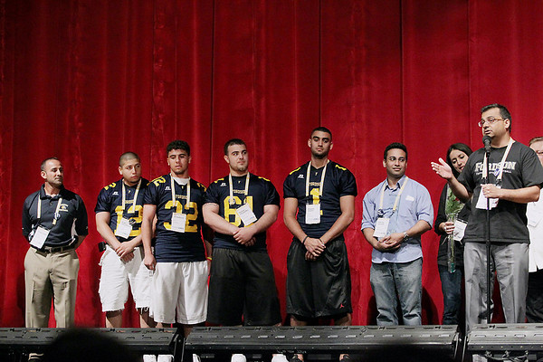 """Record-Eagle/Keith King<br /> """"Fordson: Faith-Fasting-Football,"""" wins the Jury Award for the Best United States Documentary as Rashid Ghazi, from right, director and executive producer, Basma Babar-Quraishi, producer and Ash-har Quraishi, producer, stand near Fordson High School football players from the film, Baquer Sayed, from right, Hassan Houssailky, Ali Baidoun and Bilal Abu-Omarah as well as the Fordson High School football head coach, Fouad Zaban, far left, Saturday, July 30, 2011 during the Traverse City Film Festival Awards Ceremony at the State Theatre. z"""