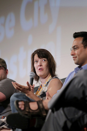 """Record-Eagle/Keith King<br /> Filmmaker Jennifer Latham, sitting next to Ash-har Quraishi, journalist and co-producer of the film, """"Fordson: Faith, Fasting, Football,"""" talks Saturday, July 30, 2011 during the Traverse City Film Festival """"Who's Killing Hollywood in Michigan,"""" panel discussion at the City Opera House."""