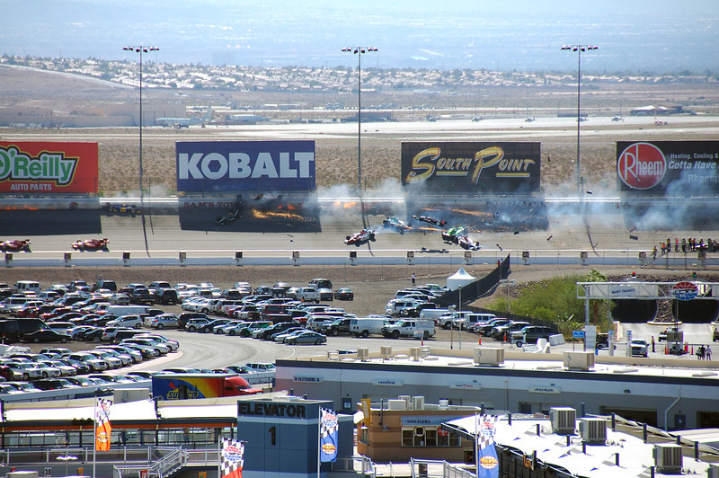 Weldon's car lost smoke below the Kobalt billboard.<br /> Will Power flying through the air with car still intact.