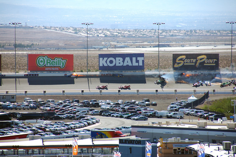Weldon's car upside down in middle of track betwen Kobalt and South Point billboards.<br /> Notice car of Will Power entering picture on right.