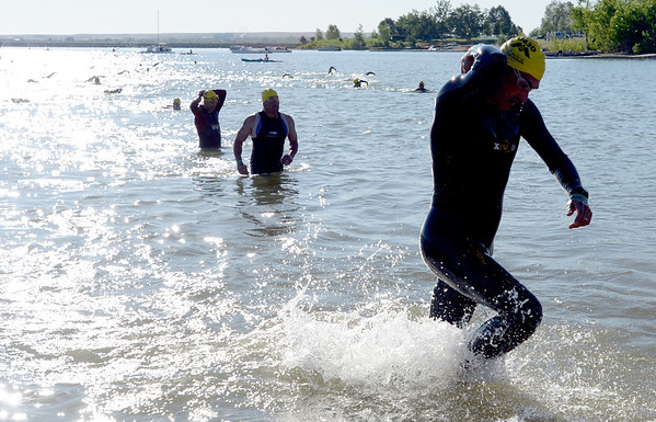 """Athletes finish the swim leg of the 2012 Boulder 5430 Sprint Triathlon on Sunday at the Boulder Reservoir. <br /> For more photos and a video of the triathlon, go to  <a href=""""http://www.dailycamera.com"""">http://www.dailycamera.com</a>.<br /> Cliff Grassmick / June 17, 2012"""