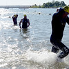 "Athletes finish the swim leg of the 2012 Boulder 5430 Sprint Triathlon on Sunday at the Boulder Reservoir. <br /> For more photos and a video of the triathlon, go to  <a href=""http://www.dailycamera.com"">http://www.dailycamera.com</a>.<br /> Cliff Grassmick / June 17, 2012"