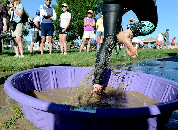 "Athletes clean their feet in the transition from swim to bike in the 2012 Boulder 5430 Sprint Triathlon on Sunday at the Boulder Reservoir. <br /> For more photos and a video of the triathlon, go to  <a href=""http://www.dailycamera.com"">http://www.dailycamera.com</a>.<br /> Cliff Grassmick / June 17, 2012"