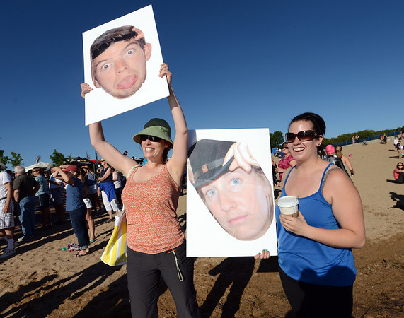 "Jen Pierce, left, and Leanna Borrelly, wanting to keep a low profile, brought visual aids to encourage their athletes in the  2012 Boulder 5430 Sprint Triathlon on Sunday at the Boulder Reservoir. <br /> For more photos and a video of the triathlon, go to  <a href=""http://www.dailycamera.com"">http://www.dailycamera.com</a>.<br /> Cliff Grassmick / June 17, 2012"