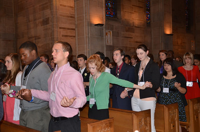 The youth chosen to represent their parishes as youth of the year pray during the Mass of Recognition celebrated at the Cathedral of Christ the King, Atlanta, on March 3. (Photos by Cindy Connell Palmer)