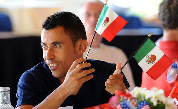 "Diego Borrega waves the flags of his country, Mexico, at the media lunch.<br /> For two videos and more photos of Bolder Boulder lunch, go to  <a href=""http://www.dailycamera.com"">http://www.dailycamera.com</a>.<br /> Cliff Grassmick / May 26, 2012"