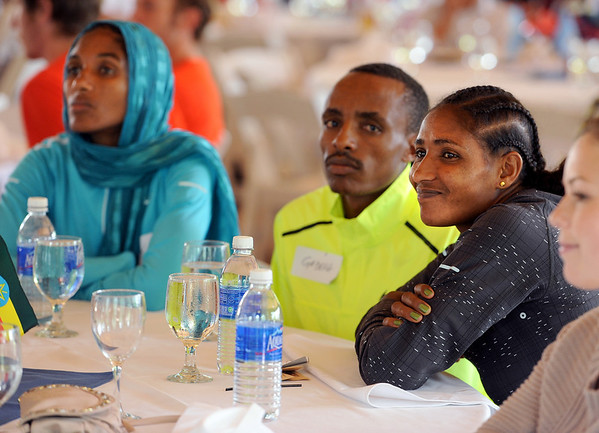 "Mamitu Daska, right, of Ethiopia with her teammates at the Bolder Boulder lunch.<br /> For two videos and more photos of Bolder Boulder lunch, go to  <a href=""http://www.dailycamera.com"">http://www.dailycamera.com</a>.<br /> Cliff Grassmick / May 26, 2012"
