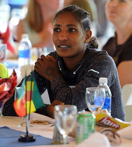 Mamitu Daska of Ethiopia  listens to speakers at the lunch. For two videos and more photos of Bolder Boulder lunch, go to www.dailycamera.com. Cliff Grassmick / May 26, 2012