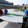 "Josh Wandescheid, left, and Thomas Sweetin, carry one of the tiles to be placed over the grass.<br /> Dozens of volunteers, some from CU Marine and Navy ROTC, helped put down the tile surface on Folsom Field on Saturday for Monday's Bolder Boulder Race.<br /> For a video and more photos of Bolder Boulder preparations, go to  <a href=""http://www.dailycamera.com"">http://www.dailycamera.com</a>.<br /> Cliff Grassmick / May 26, 2012"