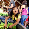 "Elida Corchado, 5, was helping her mother with the lunches for the Bolder Boulder. Volunteers packed over 54,000.<br /> For a video and more photos of Bolder Boulder preparations, go to  <a href=""http://www.dailycamera.com"">http://www.dailycamera.com</a>.<br /> Cliff Grassmick / May 26, 2012"