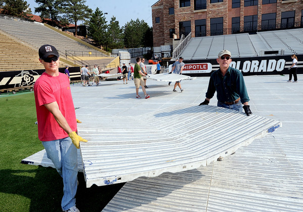 "Mike McBride, left, and Sid Gustafson, were among the volunteers helping with race preparations.<br /> Dozens of volunteers, some from CU Marine and Navy ROTC, helped put down the tile surface on Folsom Field on Saturday for Monday's Bolder Boulder Race.<br /> For a video and more photos of Bolder Boulder preparations, go to  <a href=""http://www.dailycamera.com"">http://www.dailycamera.com</a>.<br /> Cliff Grassmick / May 26, 2012"