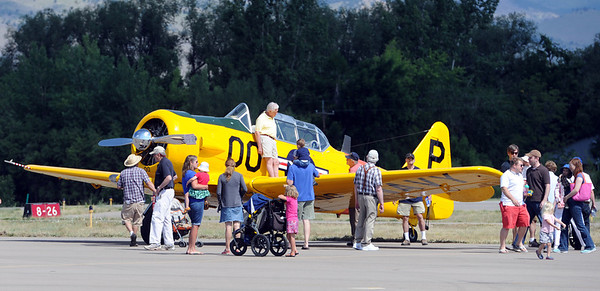 """Jack Cronin, owner and pilot of the 1953 Navy plane he is standing on, tells the crowd the details about the craft at the 7th annual Boulder Airport Day on Saturday.<br /> For more photos and a video of airport day, go to  <a href=""""http://www.dailycamera.com"""">http://www.dailycamera.com</a>.<br /> Cliff Grassmick / June 16, 2012"""