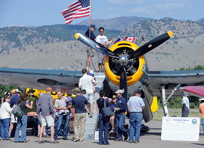 Hundreds of people attended the 7th annual Boulder Airport Day on Saturday. This WWII aircraft was one of the highlights. It is the same plane the senior  George Bush flew in the war. For more photos and a video of airport day, go to www.dailycamera.com. Cliff Grassmick / June 16, 2012