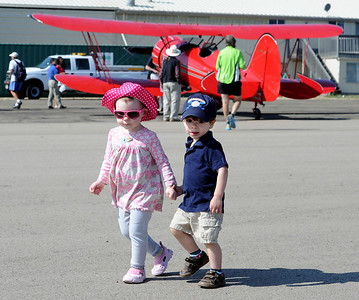Kate Beck, left, and Alex Quinonez, both 2, walk past  one of the vintage airplanes during the 7th annual Boulder Airport Day on Saturday. For more photos and a video of airport day, go to www.dailycamera.com. Cliff Grassmick / June 16, 2012
