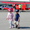 "Kate Beck, left, and Alex Quinonez, both 2, walk past  one of the vintage airplanes during the 7th annual Boulder Airport Day on Saturday.<br /> For more photos and a video of airport day, go to  <a href=""http://www.dailycamera.com"">http://www.dailycamera.com</a>.<br /> Cliff Grassmick / June 16, 2012"