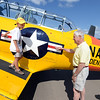 "Lawrence Matarrese, 6, gets a close up look at this 1953 Navy plane, owned by Jack Cronin, right, at the 7th annual Boulder Airport Day on Saturday.<br /> For more photos and a video of airport day, go to  <a href=""http://www.dailycamera.com"">http://www.dailycamera.com</a>.<br /> Cliff Grassmick / June 16, 2012"