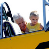 "Pilot and owner, Jack Cronin, holds up Braidon Petersen, 3, to take a closer look at his 1953 Navy plane at the 7th annual Boulder Airport Day on Saturday.<br /> For more photos and a video of airport day, go to  <a href=""http://www.dailycamera.com"">http://www.dailycamera.com</a>.<br /> Cliff Grassmick / June 16, 2012"