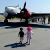 """Hey Kate, Let's take a look at this one.""<br /> Alex Quinonez, left, and Kate Beck, both 2, walk over to one of the vintage airplanes during the 7th annual Boulder Airport Day on Saturday.<br /> For more photos and a video of airport day, go to  <a href=""http://www.dailycamera.com"">http://www.dailycamera.com</a>.<br /> Cliff Grassmick / June 16, 2012"