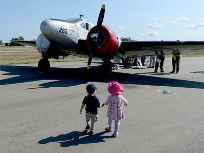 """Hey Kate, Let's take a look at this one."" Alex Quinonez, left, and Kate Beck, both 2, walk over to one of the vintage airplanes during the 7th annual Boulder Airport Day on Saturday. For more photos and a video of airport day, go to www.dailycamera.com. Cliff Grassmick / June 16, 2012"