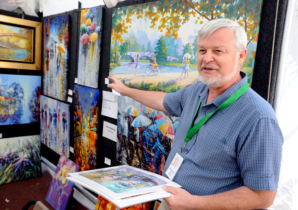 "Russian painter Stanislav Sidorov, who now lives in Aurora, talks about his work at his booth on the Mall on Saturday.<br /> The 25th Annual Downtown Boulder Fall Festival is being held on the Pearl Street Mall this weekend<br /> Boulder County's favorite fall celebration brings music, food, arts and a children's carnival.<br /> For more photos and a video of theFall Festival, go to  <a href=""http://www.dailycamera.com"">http://www.dailycamera.com</a>.<br /> Cliff Grassmick  / September 22, 2012"