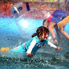 "Kate Thomas, 5, runs on all fours in one of the Wow Bubbles in the kid's area of the Fall Festival. <br />  The 25th Annual Downtown Boulder Fall Festival is being held on the Pearl Street Mall this weekend<br /> Boulder County's favorite fall celebration brings music, food, arts and a children's carnival.<br /> For more photos and a video of theFall Festival, go to  <a href=""http://www.dailycamera.com"">http://www.dailycamera.com</a>.<br /> Cliff Grassmick  / September 22, 2012"