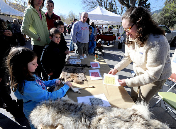 "Maryssa Dominguez, 5, left, gets  a feel for animals with help from Stephanie Muirhead, of  the Thorne Nature Experience at the market.<br /> The first day of the 2012 Boulder County Farmers' Market was Saturday near Central Park.<br /> For photos and a video of the market, go to  <a href=""http://www.dailycamera.com"">http://www.dailycamera.com</a>.<br /> Cliff Grassmick / April 7, 2012"