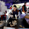 "Nancy Tu,  of Sister's Pantry, makes dumplings for customers at the Farmers' Market on Saturday.<br /> The first day of the 2012 Boulder County Farmers' Market was Saturday near Central Park.<br /> For photos and a video of the market, go to  <a href=""http://www.dailycamera.com"">http://www.dailycamera.com</a>.<br /> Cliff Grassmick / April 7, 2012"