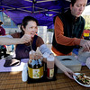 "Nancy Tu, left, and Peter Stewart, of Sister's Pantry, serve up food at the Farmers' Market on Saturday.<br /> The first day of the 2012 Boulder County Farmers' Market was Saturday near Central Park.<br /> For photos and a video of the market, go to  <a href=""http://www.dailycamera.com"">http://www.dailycamera.com</a>.<br /> Cliff Grassmick / April 7, 2012"