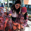 "Pamela Fletcher and her daughter, Grace put out more samples at the Outrageous Baking booth at the farmers' market.<br /> The first day of the 2012 Boulder County Farmers' Market was Saturday near Central Park.<br /> For photos and a video of the market, go to  <a href=""http://www.dailycamera.com"">http://www.dailycamera.com</a>.<br /> Cliff Grassmick / April 7, 2012"