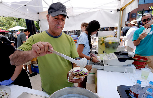 "Avner Gilady of Falafel King of Boulder, creates a masterpiece for a customer at the Boulder Jewish Festival on Sunday.<br /> For more photos and a video of the festival, go to    <a href=""http://www.dailycamera.com"">http://www.dailycamera.com</a>.<br /> Cliff Grassmick / June 10, 2012"