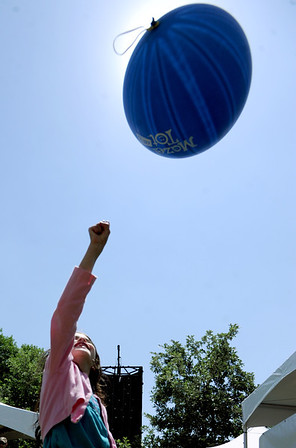 """Gabriel Shapiro, 8, punches her ball up to eclipse the sun.<br /> For more photos and a video of the festival, go to    <a href=""""http://www.dailycamera.com"""">http://www.dailycamera.com</a>.<br /> Cliff Grassmick / June 10, 2012"""