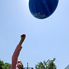 "Gabriel Shapiro, 8, punches her ball up to eclipse the sun.<br /> For more photos and a video of the festival, go to    <a href=""http://www.dailycamera.com"">http://www.dailycamera.com</a>.<br /> Cliff Grassmick / June 10, 2012"