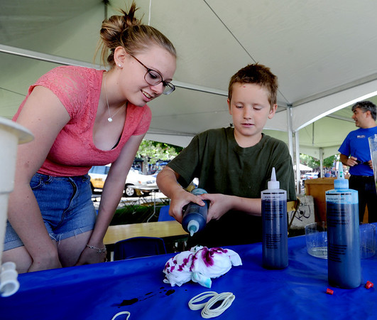 "Kate Dow, left, helps Peter Hoch, 9, with the making of a T-shirt at the Boulder Jewish Festival.<br /> For more photos and a video of the festival, go to    <a href=""http://www.dailycamera.com"">http://www.dailycamera.com</a>.<br /> Cliff Grassmick / June 10, 2012"
