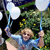 "Josh Shoenfeld hands out balloons to promote Camp HarHaShem in Boulder during the Boulder Jewish Festival.<br /> For more photos and a video of the festival, go to    <a href=""http://www.dailycamera.com"">http://www.dailycamera.com</a>.<br /> Cliff Grassmick / June 10, 2012"