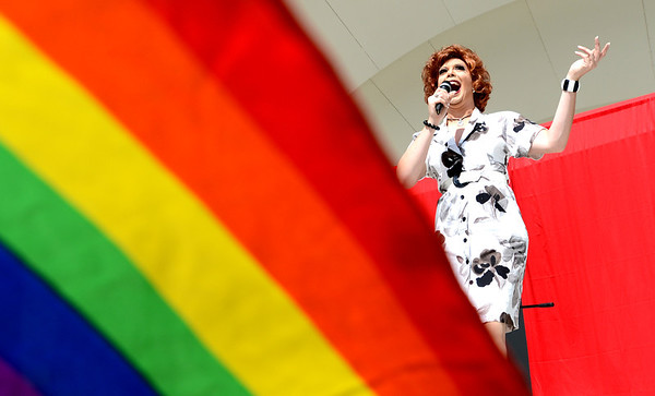 "Ms. Eda Bagel, the drag queen MC, sings during the Boulder PrideFest on Sunday at Central Park.<br /> The Boulder PrideFest is a celebration of all the LGBTQ people in the Boulder community.<br /> For more photos and a video of the festival, go to  <a href=""http://www.dailycamera.com"">http://www.dailycamera.com</a>.<br /> Cliff Grassmick  / September 16, 2012"