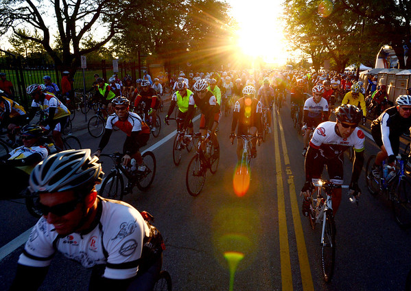 """Riders begin the 100-mile """"Buff Epic"""" ride just after sunrise.<br /> Hundreds of riders participated in the Buffalo Bicycle Classic starting at the University of Colorado on Sunday. The ride is the largest source of scholarship money for  CU's College of Arts and Sciences.<br /> For more photos and a video of the classic, got o  <a href=""""http://www.dailycamera.com"""">http://www.dailycamera.com</a>.<br /> Cliff Grassmick  / September 9, 2012"""
