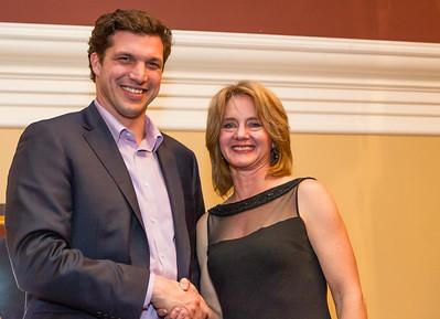 Director Jennifer Brenning congratulates Coach of the Year Zoltan Csepregi