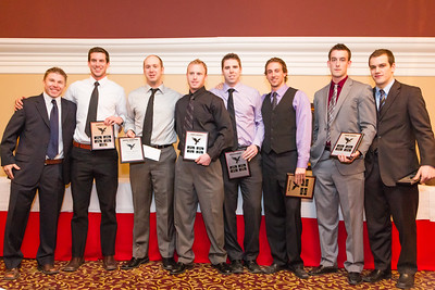 Coach Marty Johnston and Mens hockey award recipients