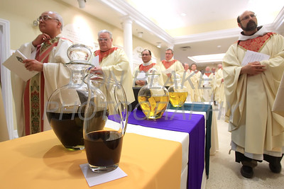 Priests from around the Diocese pass the oils as they process to the alter during Chrism Mass at Holy Cross Church in Dover, Del., Monday, April 2, 2012. photo/www.DonBlakePhotography.com